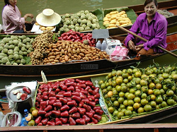 Mangoes, rose apples, custard apples, and oranges are among the fruits for sale at Damneon Saduak floating