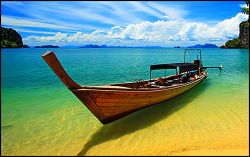 boat parked on the clear water of Koh Samet